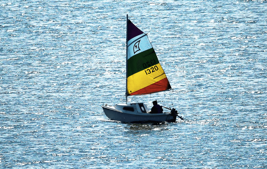 Get involved by sharing your photos of the lakes. (Sailboat on Lake Mendota)